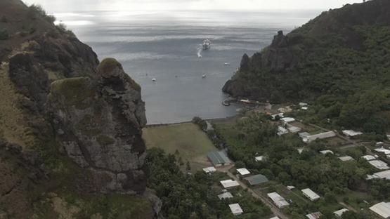 Aerial drone view of Fatu Hiva, village and bay of Hanavave, Marquesas islands, Polynesia, 2K7