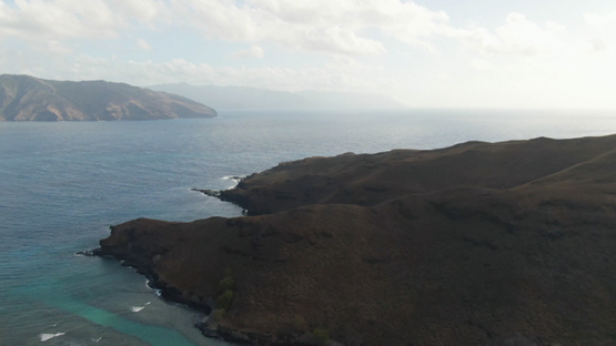 Aerial drone shot of the oceanic coast and mountains of Tahuata, Marquesas islands, French Polynesia, 2K7