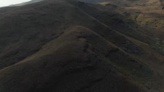 Aerial drone shot of the hills of Tahuata, Marquesas islands, French Polynesia, 2K7
