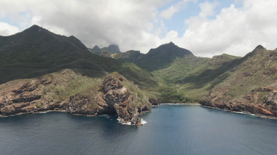 Aerial drone view of Ua Pou, Pillars and mountains from the bay and ocean, Marquesas islands, Polynesia, 2K7