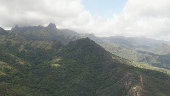 Ua Pou, Aerial drone view of peaks and mountains in clouds, Marquesas islands, Polynesia, 2K7