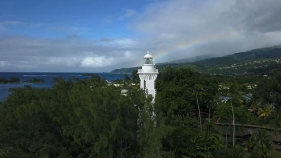 Aerial drone view of Tahiti, lighthouse of Pointe Venus and rainbow, French Polynesia