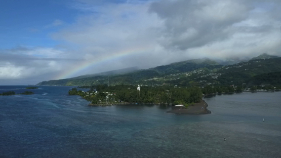 Aerial drone view of Tahiti, rainbow over the lighthouse of Pointe Venus, French Polynesia