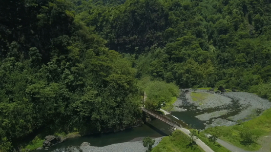 Tahiti Aerial drone view, Valley of Papenoo, bridge above the river in the valley of Papenoo, French Polynesia