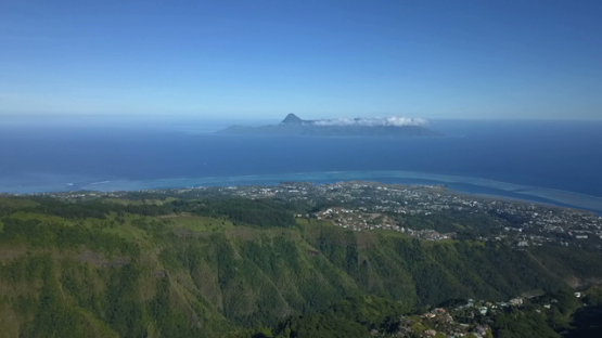Aerial drone view of Tahiti, Papeete and Moorea island under blue sky, French Polynesia