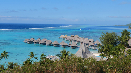 Overwater bungalows of a luxury hotel in the lagoon of Moorea, French Polynesia 4K UHD