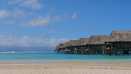 Overwater bungalows of a luxury hotel in the lagoon of Moorea, French Polynesia, 4K UHD