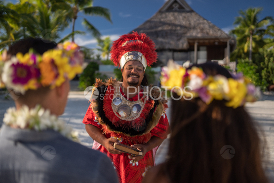 Polynesian preacher celebrating the traditional wedding of couple of tourists, Bora Bora