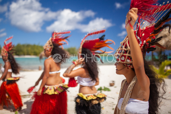 Bora Bora, group of polynesian dancers with traditional costume on the beach