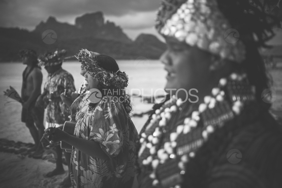 Bora Bora, dancers with traditional costume on the beach, black and white
