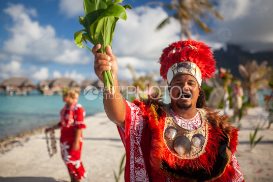 Polynesian preacher welcoming couple for taditional weeding on the beach, Bora Bora
