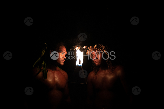 BORA BORA, PORTRAIT OF POLYNESIAN MEN WITH FIRE TORCH AT NIGHT