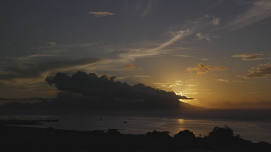 Sunset and clouds on the island of Moorea, time lapse 4K UHD