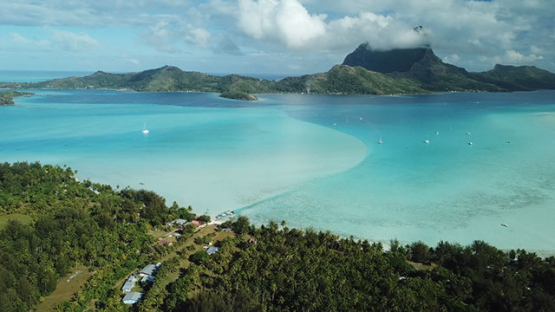 Aerial view of the island Bora Bora and the lagoon, drone shot 4K UHD