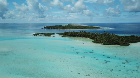 Aerial view by drone over the lagoon of Fakarava, 4K UHD