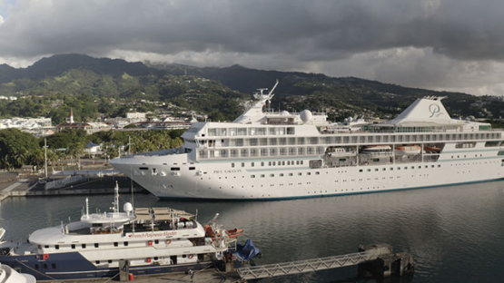Papeete, aerial view over the Cruise ship moored at the harbour, 4K UHD