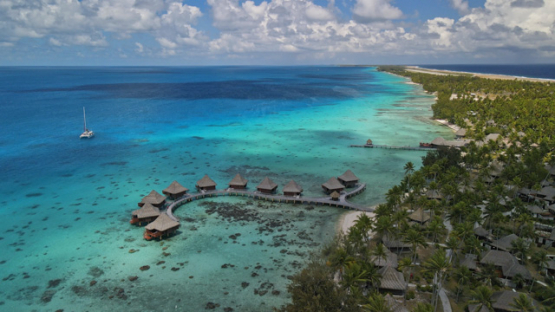 Rangiroa, aerial view of overwater hotel in the lagoon, 4K UHD