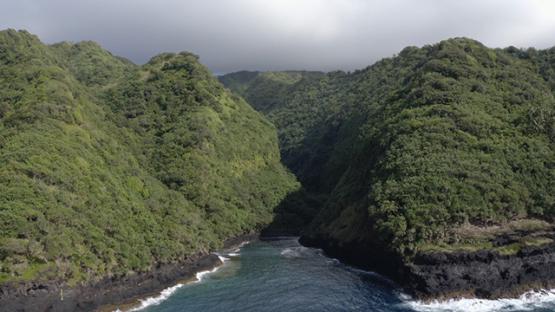 Tahiti, aerial view of cliff of Te Pari, lagoon and mountains, 4K UHD