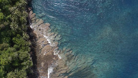 Tahiti, aerial view of Te Pari, lagoon, reef and shore, 4K UHD