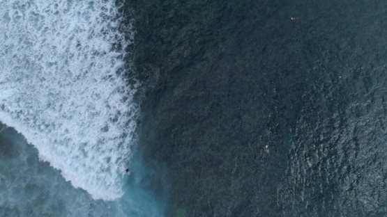 Aerial view of Tahiti, surfing the wave of Taapuna pass, 4K UHD