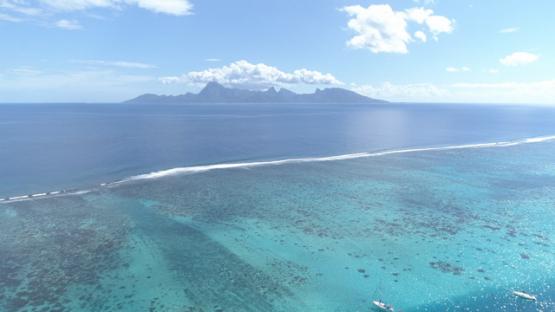 Aerial view of the island Moorea shot from Tahiti, 4K UHD