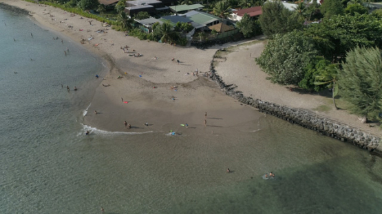 Tahiti, aerial view of people on the Beach Vaiava, Pk18 Paea, 4K UHD