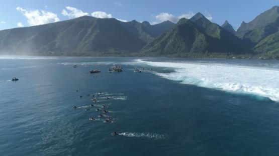 Tahiti, aerial view of group of surfer at Teahupoo, 4K UHD
