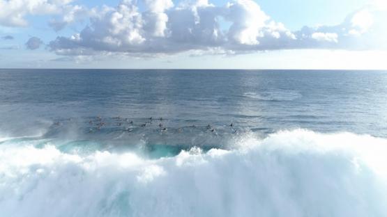 Tahiti, aerial view of surfers and wave Teahupoo, 4K UHD