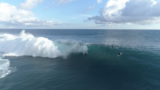 Tahiti, aerial view of the wave Teahupoo and surfers, 4K UHD