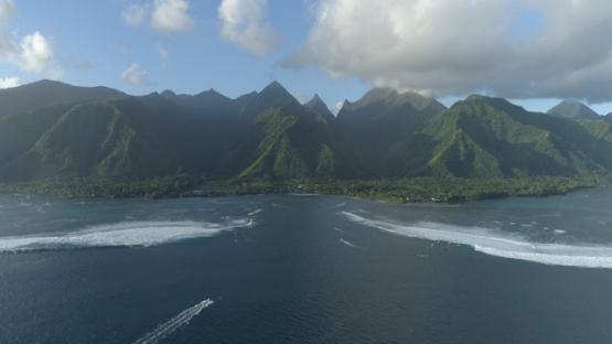 Tahiti, aerial view of the pass Teahupoo and mountains, 4K UHD