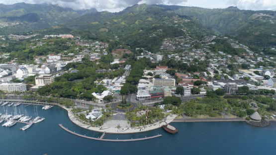 Tahiti, aerial drone shot of the seafront of town Papeete, 4K UHD