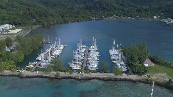 Moorea, aerial view oh f the Vaiare marina and sail boat moored, 4K UHD