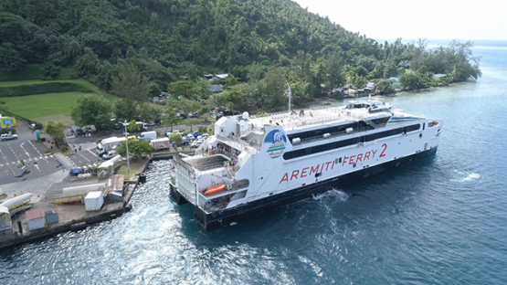 Moorea, aerial view of a ferry boat on the dock of Vaiare, 4K UHD