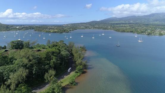 Peninsula of Tahiti, Aerial view of Taravao and sail boats anchored in the lagoon, 4K UHD