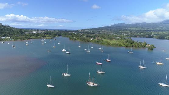 Peninsula of Tahiti, Aerial view of sail boats anchored in the lagoon of Taravao, 4K UHD