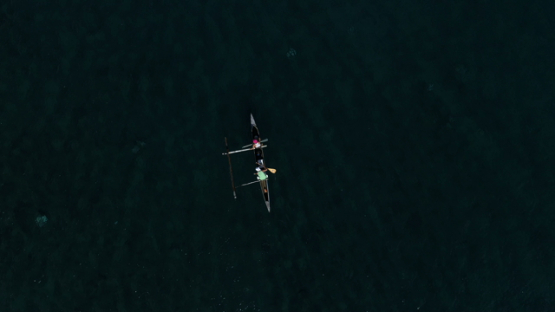 Peninsula of Tahiti, Aerial view of two people in an outrigger canoe, 4K UHD