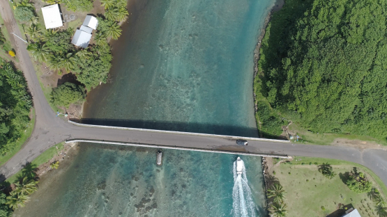 Huahine, aerial view above the bridge between islands in the lagoon, 4K UHD