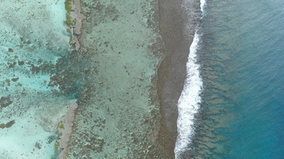Tahaa, aerial view above the barrier reef, 4K UHD
