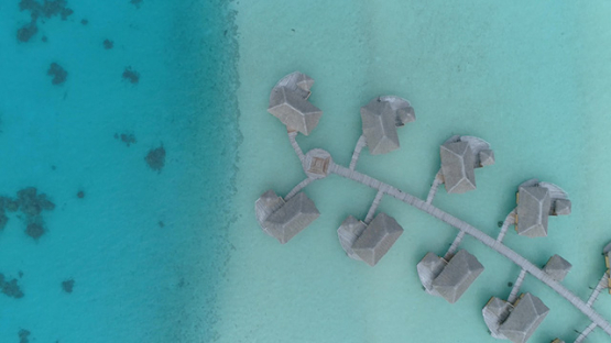 Tahaa, aerial view above a luxury hotel in the lagoon, 4K UHD