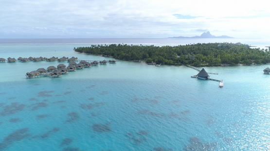 Tahaa, aerial view of an luxury overwater hotel in the lagoon, 4K UHD