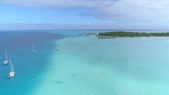 Tahaa, aerial view of sail boats anchored in the lagoon, and hotel, 4K UHD
