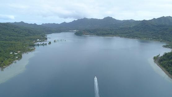 Tahaa, aerial view of a motor boat navigating in Haamene bay, 4K UHD