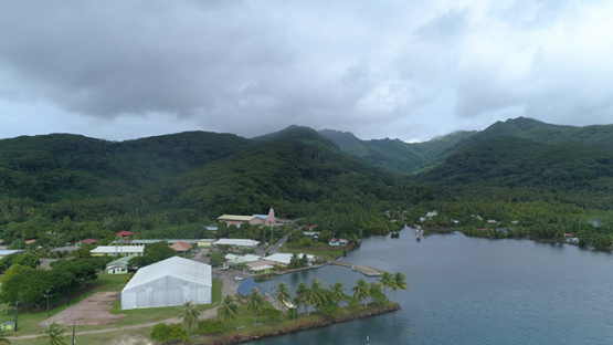 Tahaa, aerial view of the the village Patio and church, 4K UHD
