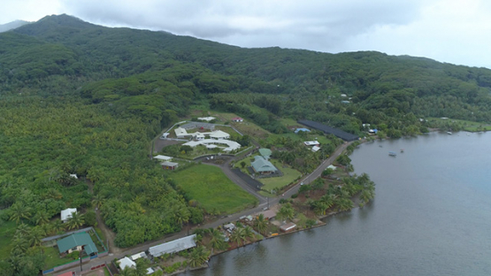 Tahaa, aerial view of the the village Patio and school, 4K UHD
