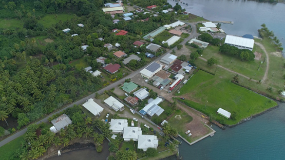 Tahaa, aerial view of the the village center of Patio, 4K UHD