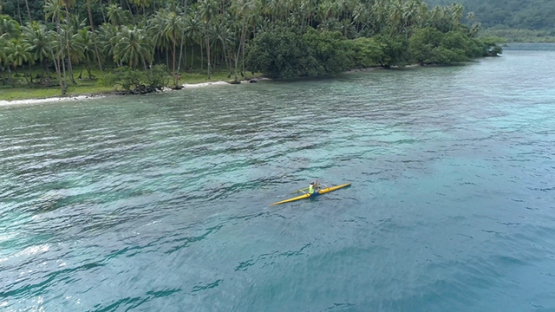 Tahaa, aerial view of outrigger paddler in the lagoon, 4K UHD