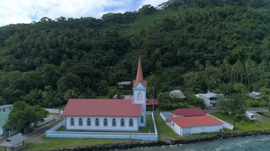 Tahaa, aerial view of Church Tiva along the lagoon, 4K UHD
