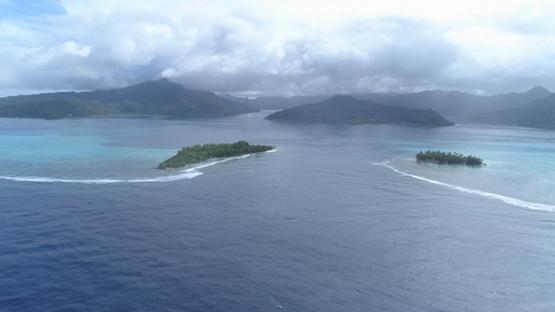 Tahaa, aerial view of the pass and motu Toahotu, island and lagoon, 4K UHD