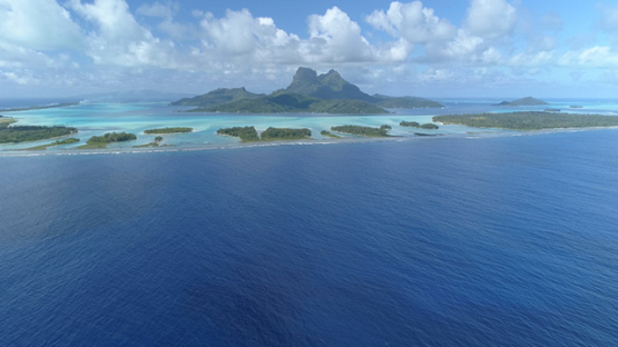 Bora Bora, aerial view of the island and its lagoon, 4K UHD