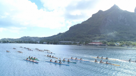 Bora Bora, aerial view of a race of traditional outrigger canoes in the lagoon, 4K UHD